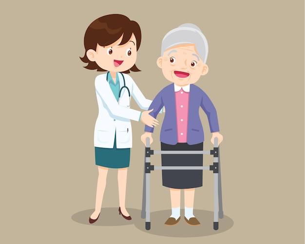 Il dottore aiuta sua nonna ad andare dal camminatore
