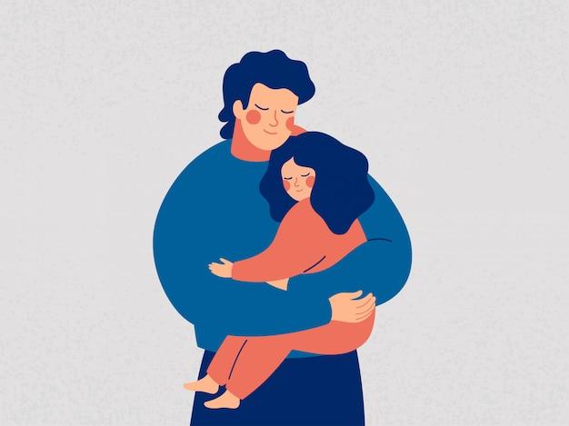 Il giovane padre tiene sua figlia con cura e amore. felice giorno di padri concetto