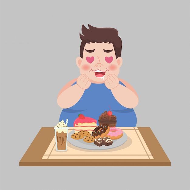 Il grande uomo felice grasso gode di mangia il dessert dolce