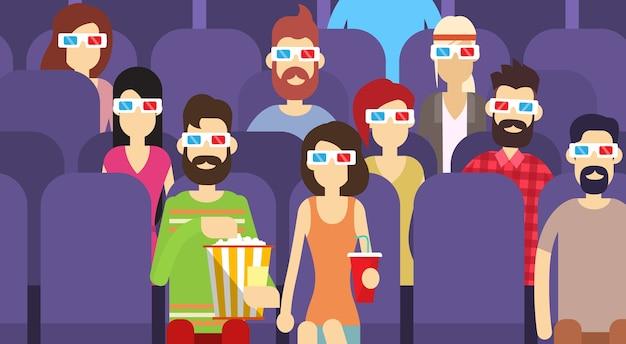 Il gruppo della gente si siede guardando il film in vetri del cinema 3d