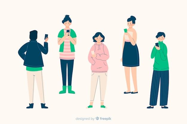 Il gruppo di persone che esaminano gli smartphones ha illustrato insieme