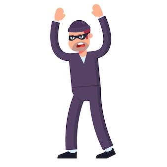 Il ladro si arrende alza le mani in alto. catturato sulla scena del crimine. piatto