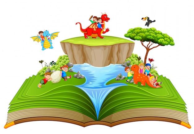 Il libro di fiabe verde dei bambini che giocano con il drago vicino al fiume