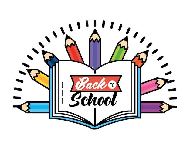 Il libro di istruzione con le matite colora i rifornimenti