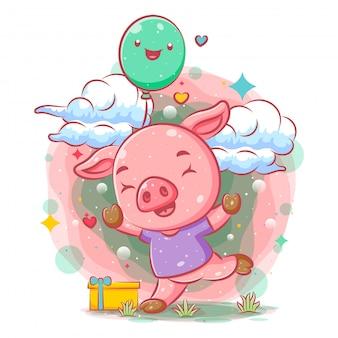Il maiale rosa felice tiene i palloncini verdi dell'illustrazione