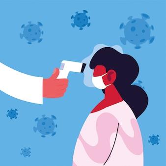Il medico misura la temperatura di una donna in una maschera medica, prevenzione del coronavirus