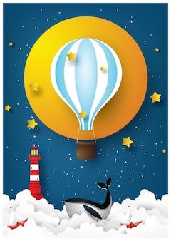 Il mondo dei sogni. balene blu e barca a vela nel mare di notte.