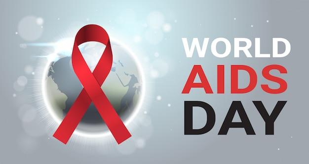Il nastro rosso di consapevolezza della giornata mondiale dell'aids firma sopra la prevenzione medica internazionale della mappa di mondo
