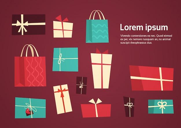 Il pacchetto differente dei presente della raccolta dei contenitori di regalo con i nastri ha fissato il concetto di festa