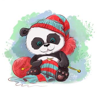 Il panda dell'acquerello del fumetto lavora a maglia una sciarpa.