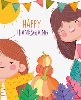Il partito felice di ringraziamento con le ragazze sorridenti con le zucche lascia la celebrazione della ghirlanda