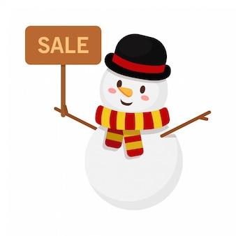 Il pupazzo di neve di natale sostiene il segno di vendita