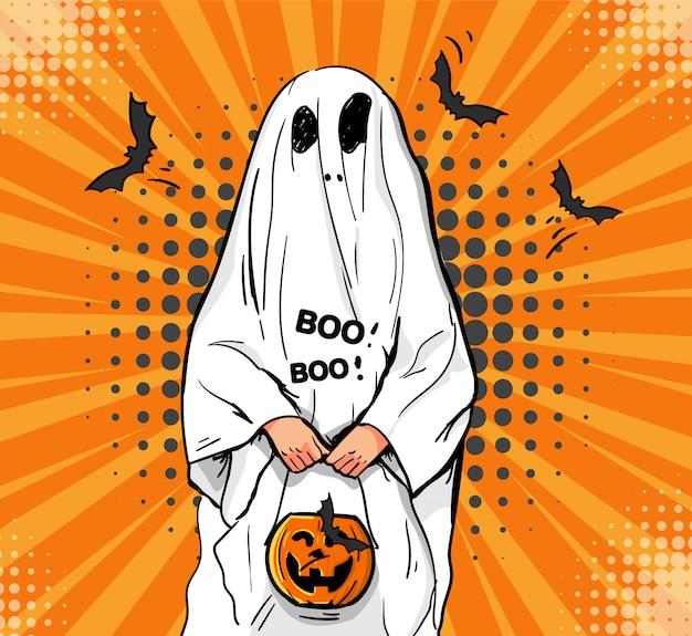 Il ragazzino in un costume fantasma spaventa.