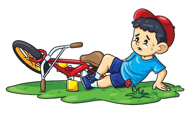 Il ragazzo cade da una bicicletta