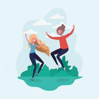 Il ragazzo e la ragazza saltano nel parco