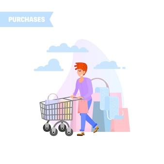 Il ragazzo porta un carrello pieno di acquisti.