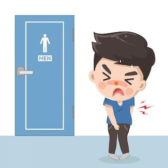 Il ragazzo soffre di mal di stomaco e ha bisogno di fare la cacca davanti al bagno.