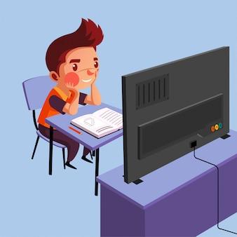 Il ragazzo studia davanti alla tv durante la pandemia