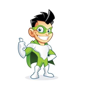 Il ragazzo sveglio del supereroe che mostra i pollici aumenta il segno