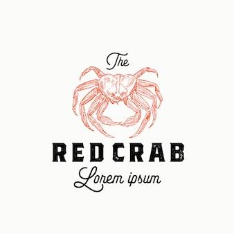 Il segno astratto del granchio rosso, simbolo o modello di logo. sillhouette di granchio disegnato a mano con retro tipografia. emblema o timbro vintage. isolato.