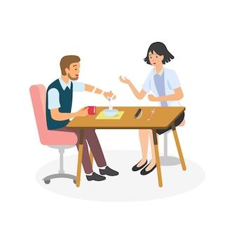 Il terapeuta che allena il cliente dell'emiplegia per muovere la mano con la stecca per mangiare.