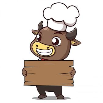 Il toro chef tiene un cartello con lo spazio per mettere giù il tuo messaggio.