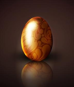 Illustrazione dell'uovo di pasqua dorato con l'ornamento