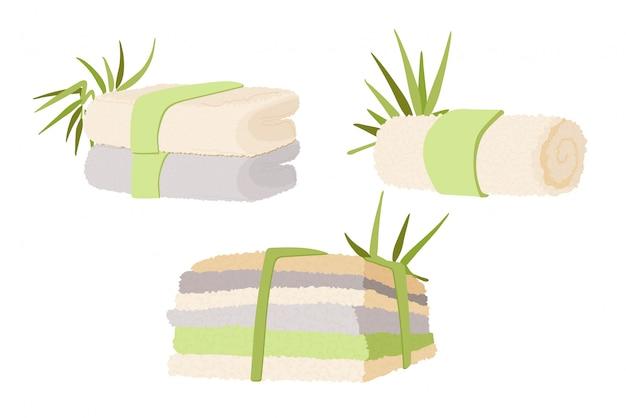 Illustrazione di asciugamani in bambù e cotone naturali per casa, spa e hotel.