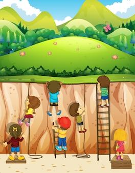 Illustrazione di bambini che si arrampicano su per la scogliera