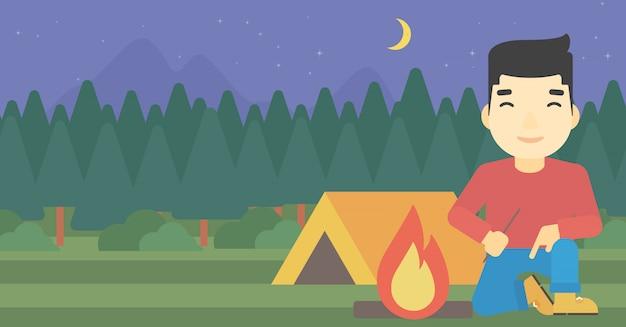 Illustrazione di vettore del fuoco di accampamento dell'uomo.