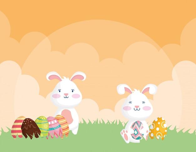Illustrazione felice di celebrazione di pasqua con i conigli e le uova dipinti