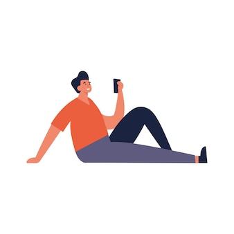 Illustrazione giovane uomo in piedi e utilizzando il dispositivo mobile.