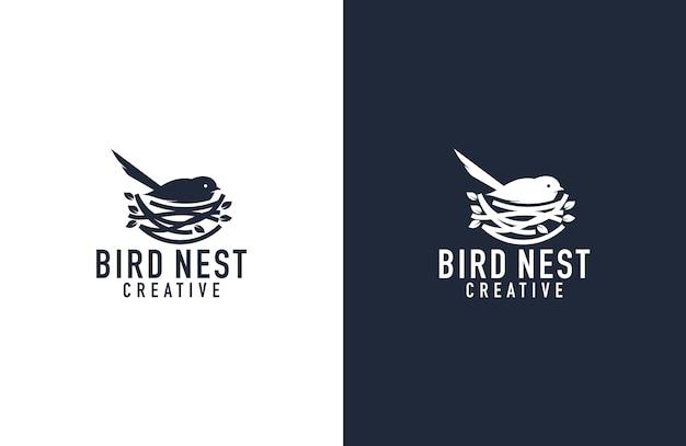 Illustrazione impressionante di logo del nido e dell'uccello
