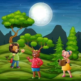 Illustrazione molti animali nella scena notturna