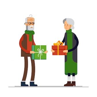 Illustrazione piatta di coppia di anziani festeggia il natale e fare un regalo. nonno e nonna pronti a festeggiare