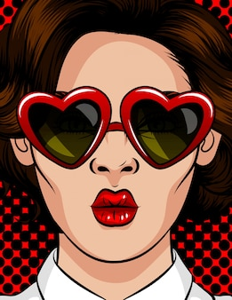 Illustrazione vettoriale di colore in stile pop art. la donna in occhiali da sole a forma di cuore. la donna manda un bacio. bella donna con gli occhiali bruna con uno stile di 60-80 in una cornice di plastica