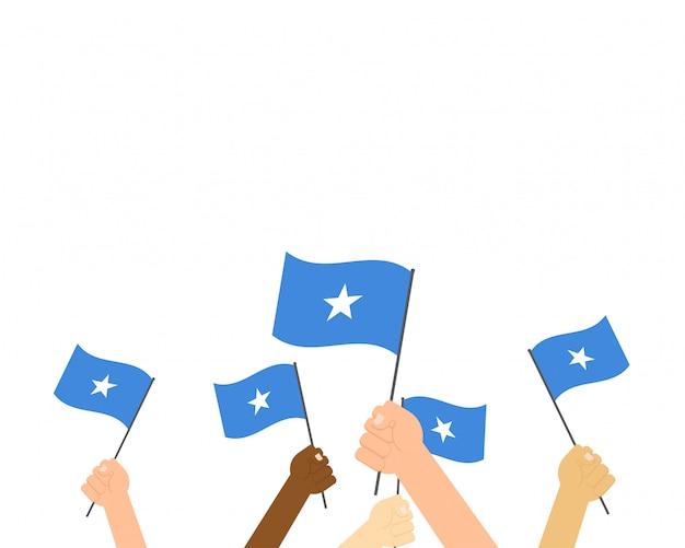 Illustrazione vettoriale di mani che tengono le bandiere della somalia
