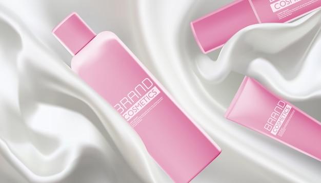 Illustrazione vettoriale di prodotti cosmetici rosa realistici con tessuto bianco satinato