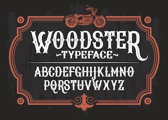 Illustrazione vettoriale di un font vintage, l'alfabeto latino in un telaio retrò con una motocicletta personalizzata.