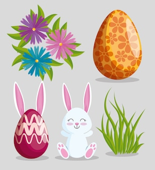 Impostare il coniglio di pasqua con decorazione di uova e fiori