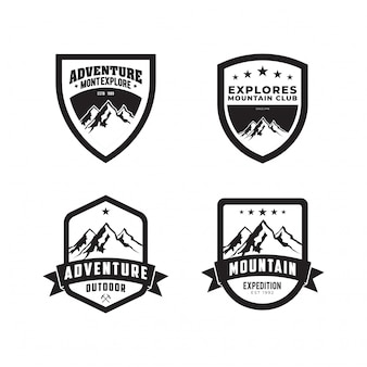 Impostare il logo di vettore di avventura all'aperto di montagna