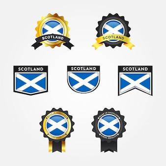 Impostare la bandiera della scozia e realizzato in etichette distintivo emblema della scozia