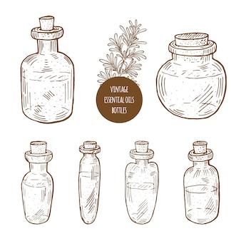 Imposti l'illustrazione disegnata a mano delle bottiglie di olio essenziale