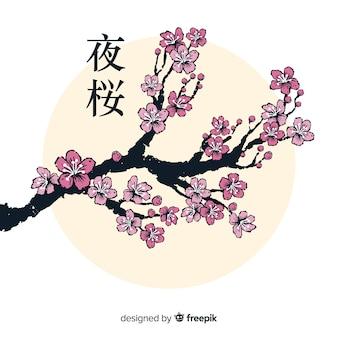 Inchiostro ramo di fiori di ciliegio sullo sfondo