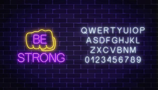 Insegna al neon d'ardore del pugno umano con il desiderio di essere forte con l'alfabeto. supporto di amici in situazioni difficili