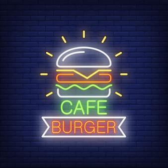Insegna al neon dell'hamburger del caffè. forma del nastro e dell'hamburger sul fondo del muro di mattoni.