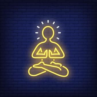 Insegna al neon della siluetta della persona di meditazione