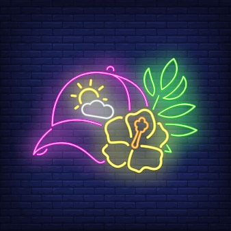 Insegna al neon di fiori e berretto.
