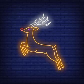 Insegna al neon in esecuzione di renne