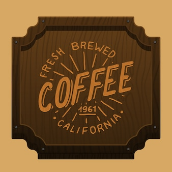 Insegna del caffè per bar o ristorante. disegnato a mano inciso. colazione del mattino. fondo in legno, vista dall'alto.